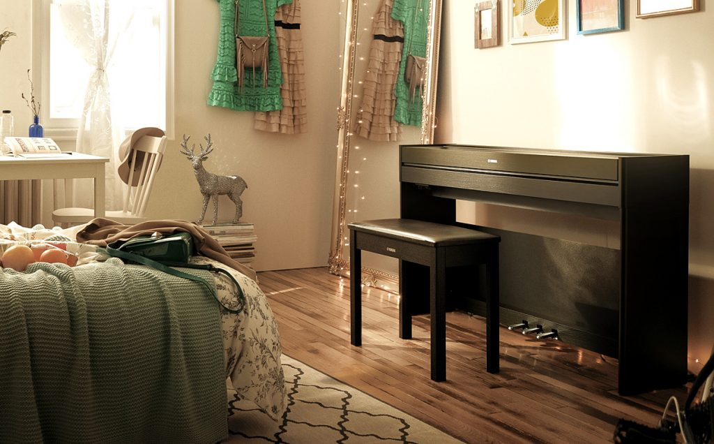 Photograph of Yamaha YDP-S54 digital piano in a bedroom with its lid closed