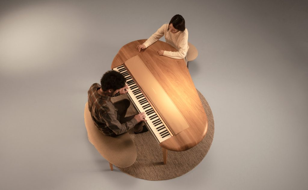 "Yamaha's A-Round concept piano from above with pianist and ""listener"""