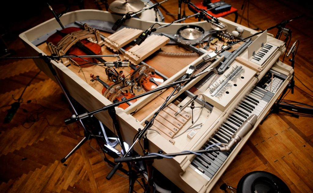"Image showing the ""Super-piano"" with additional instruments and 17 microphones"
