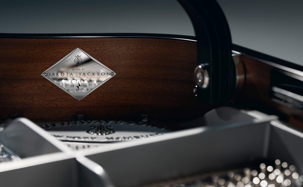 An individually numbered medallion is affixed to the inner rim