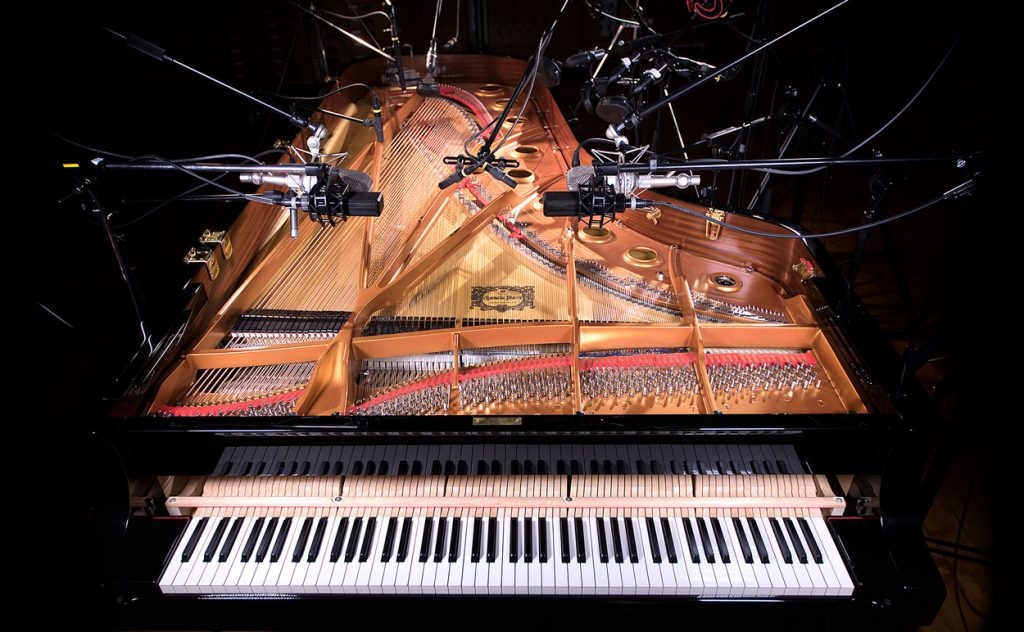 Microphones positioned around Nils Frahm's Yamaha CFX concert grand piano. The recorded samples are used to construct the NOIRE virtual piano.