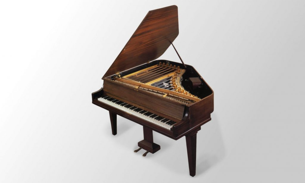 Studio shot of the Neo Bechstein piano with the lid open showing the strings and pickups