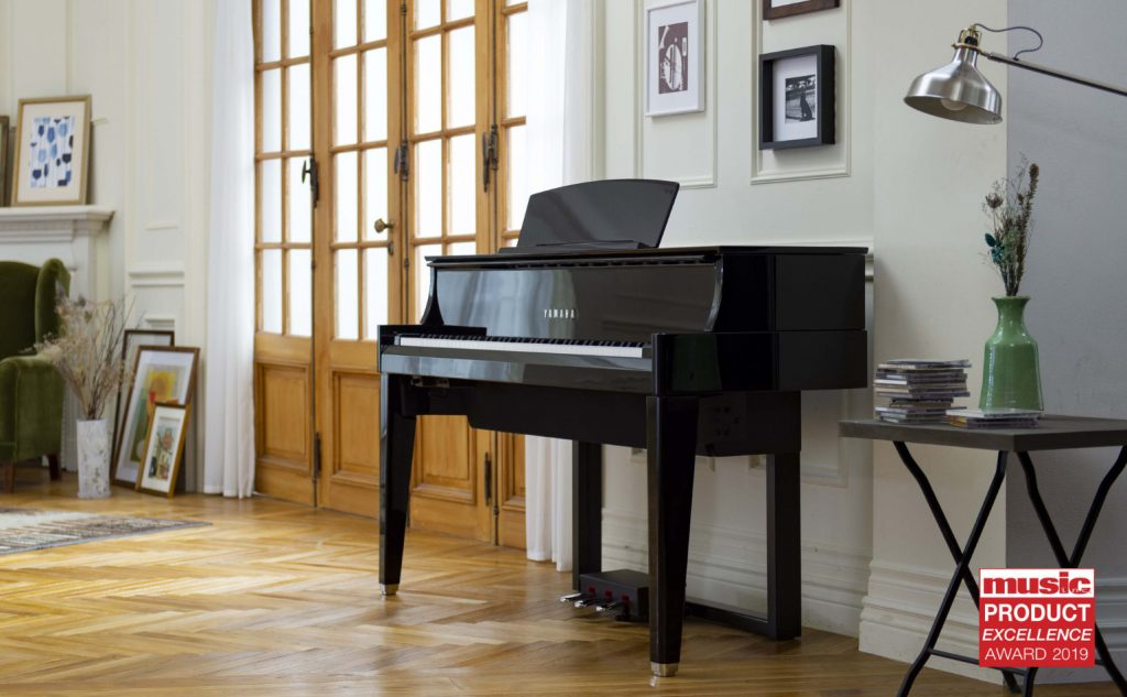 A Yamaha AvantGrand N1X hybrid piano set in a domestic drawing room