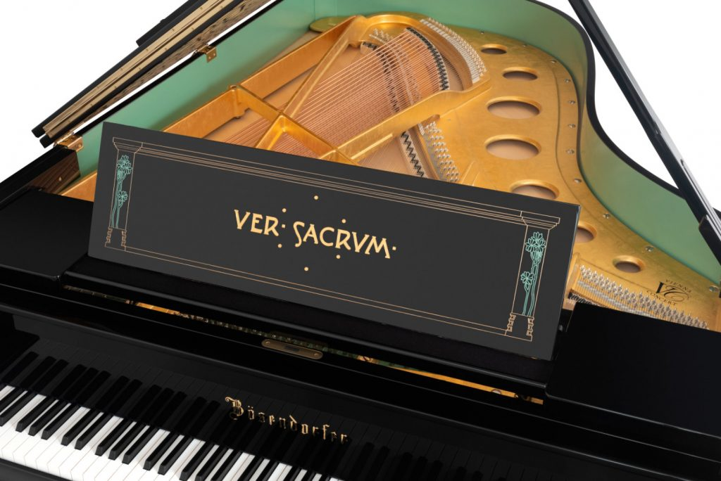 "Close-up of the Secession 214VC looking into the body of the instrument and showing the gold frame and music rest inscribed ""Ver Sacrum"""