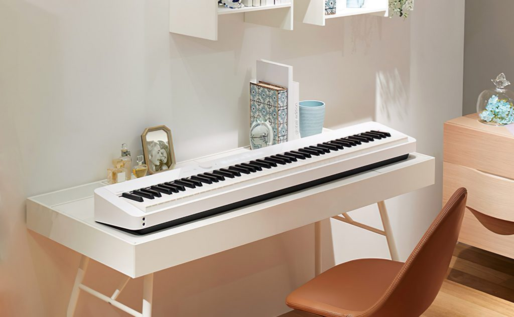 Photograph of Casio Privia PX-S1000 digital piano on table in domestic environment