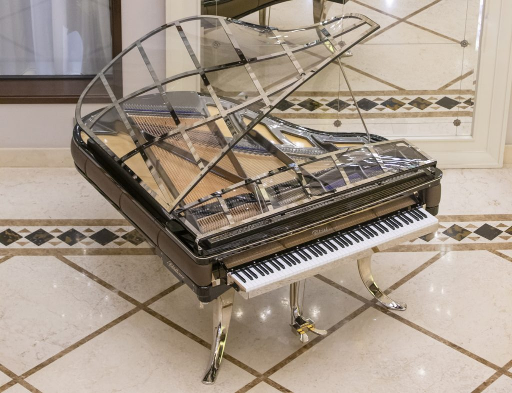 photograph from above of the PH Grand Piano in the lobby of the Hotel Ambassadori