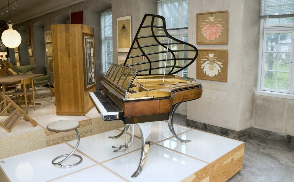 The PH Grand Piano that belonged to Poul Henningsen on display at the Danish Design Museum