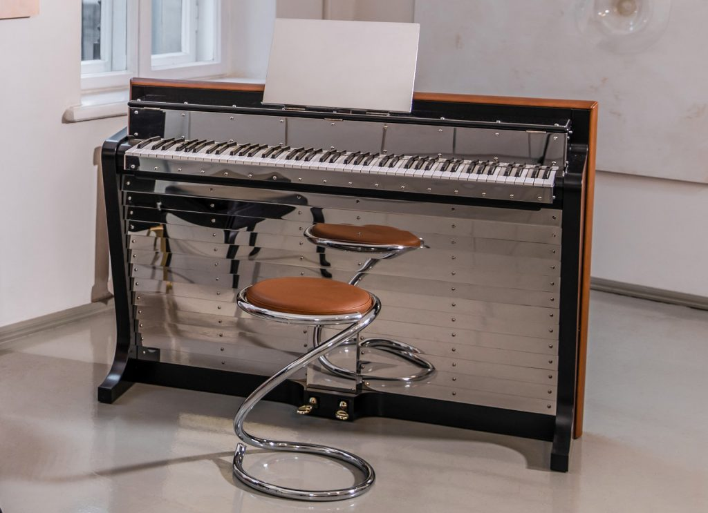 photo of restored PH Pianette by Poul Henningsen with tan coloured leather banding