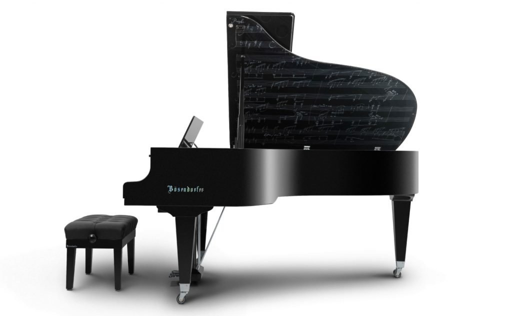 the Beethoven Model Grand Piano seen from the side with the lid open revealing part of the score of the Moonlight Sonata.