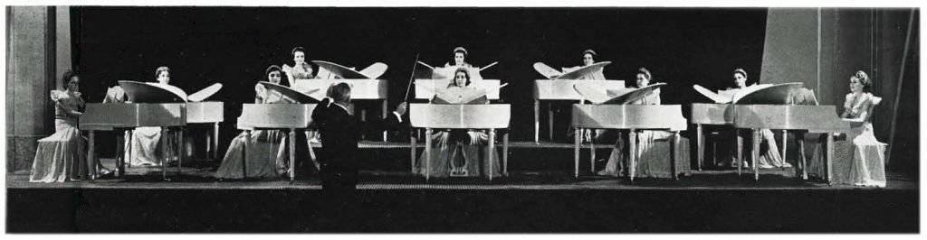 black and white image of ten women playing Wurlitzer's new Butterfly Grands