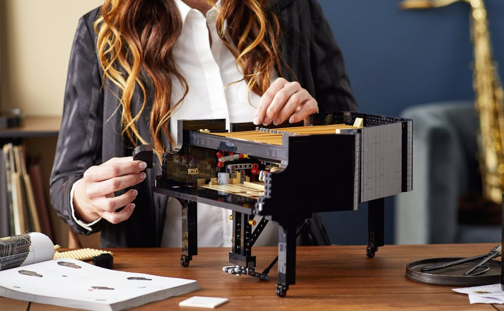 image showing girl assembling The Lego Piano