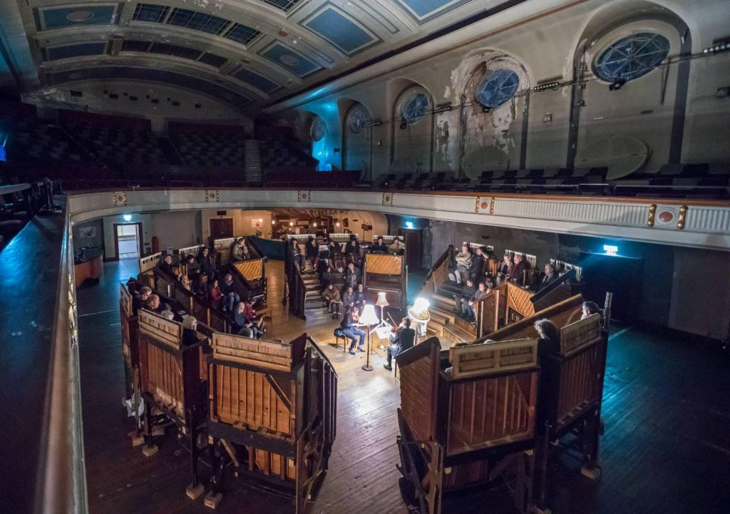 A classical concert lit by just three standard lamps in the Pianodome which has been set-up in Edinburgh's Leith Theatre.