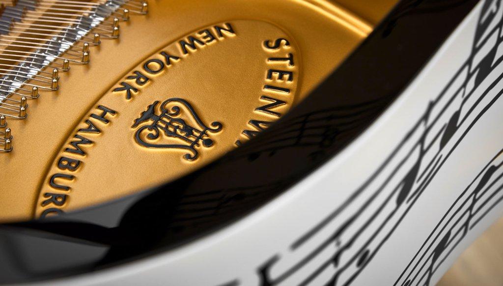 The Steinway brand on the frame of the piano