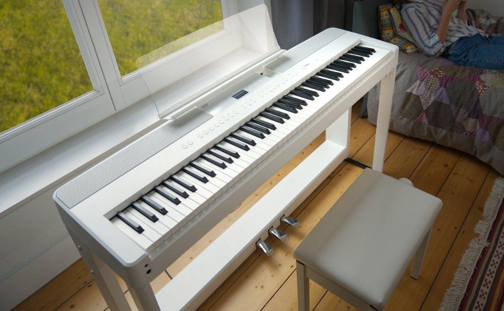 image showing Kawai ES520 in a bedroom / sitting-room.