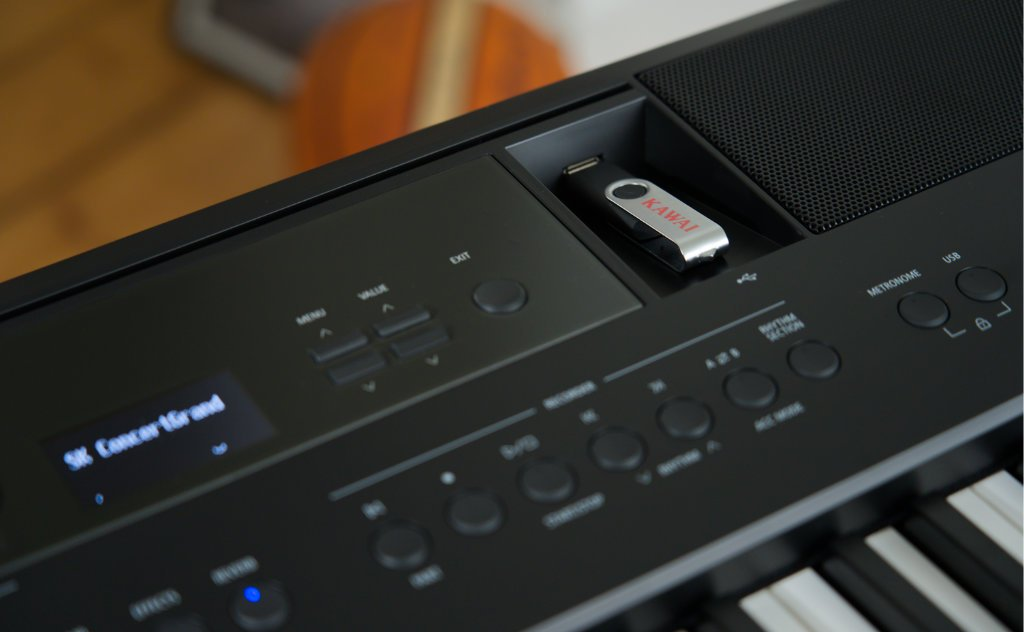 close-up of the USB port with Kawai branded usb drive