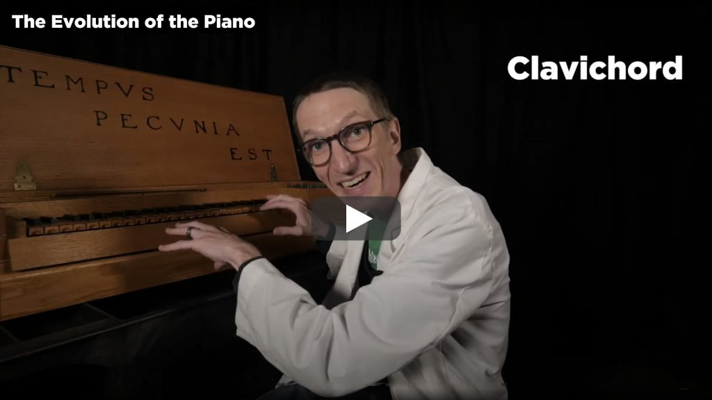 A screenshot from Part 2 of The Evolution of the Piano video. This shows Evan the Educator playing a clavichord.