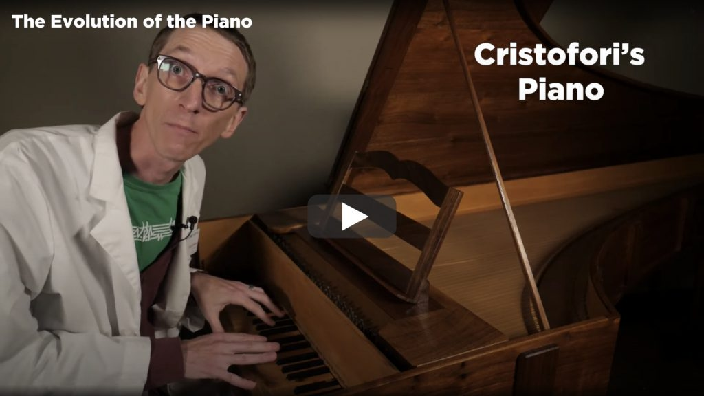 A screenshot from Part 4 of The Evolution of the Piano video. Evan plays the replica 1726 Cristofori piano
