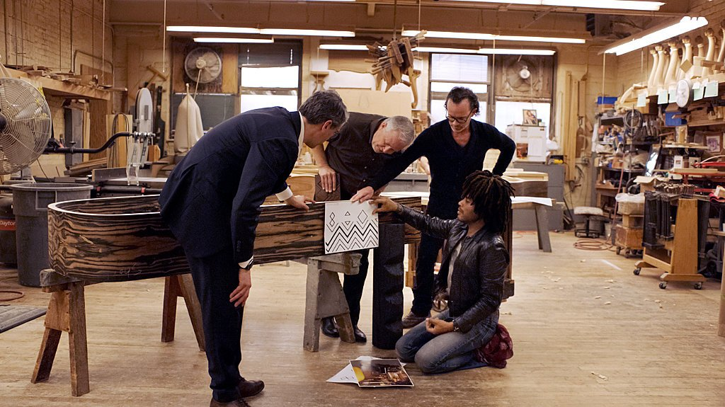 Kravitz and a team of Steinway employees discuss the designs for the rim of the piano