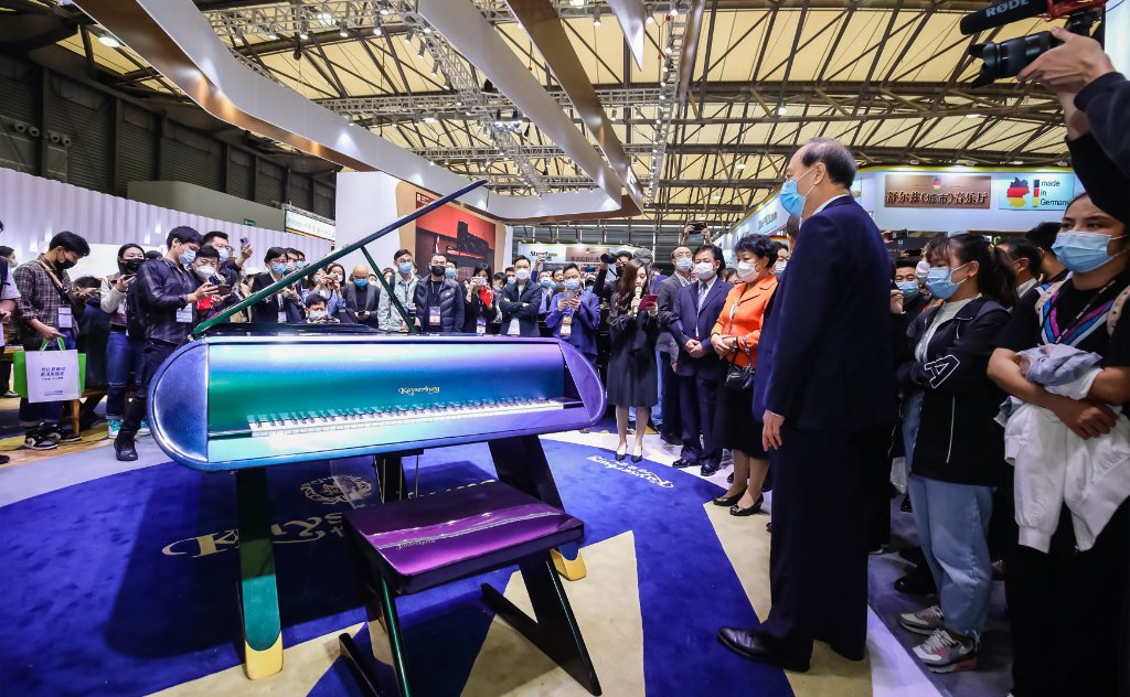 Photo of the Celestial Harmony Spacewalk piano on the Kayserburg stand surrounded by visitors