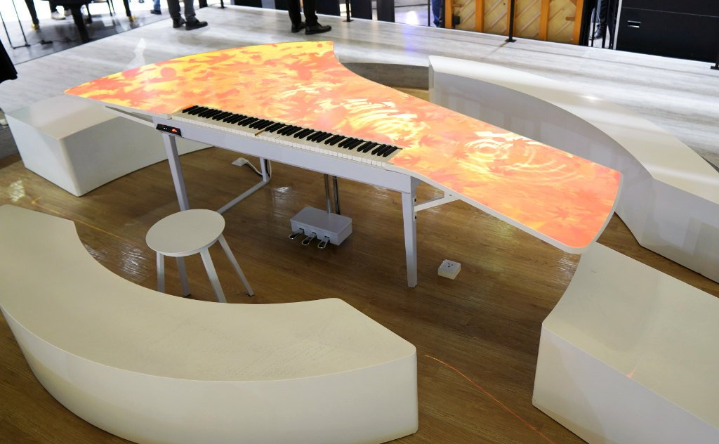 """Yamaha's """"Key Between People"""" piano installation with projected patterns on stop surface"""