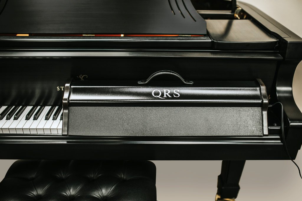image showing the QRS UV Keyboard Sanitizer positioned on a Story & Clark grand piano