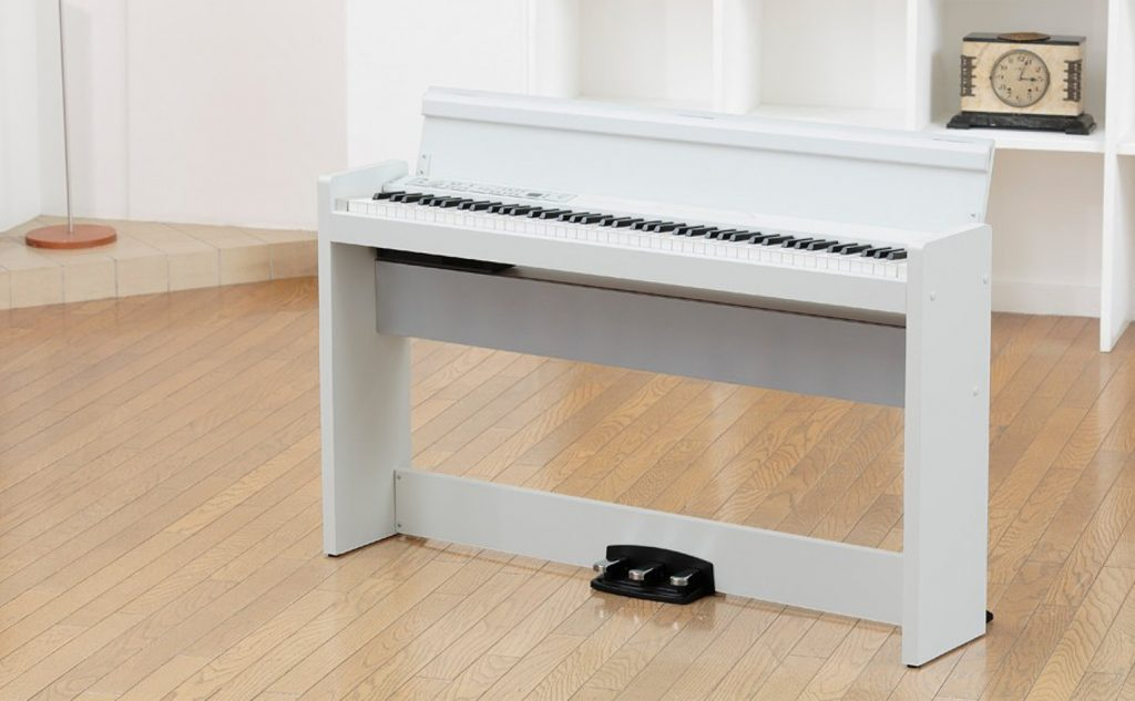 image a white Korg LP380 in a domestic setting