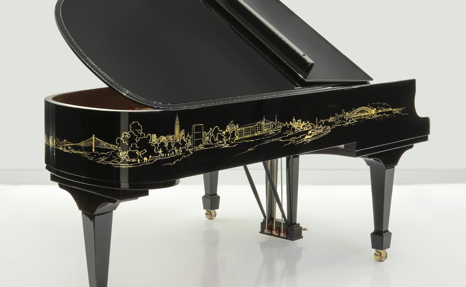 close-up of bass side of the Steinway Skyline grand piano