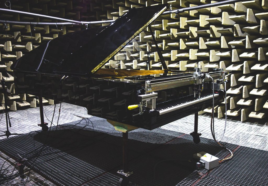 photo showing an ANT. PETROF 275 grand piano being sampled in an anechoic chamber
