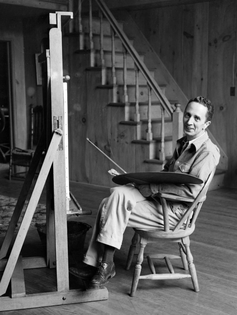 Norman Rockwell siting at his easel