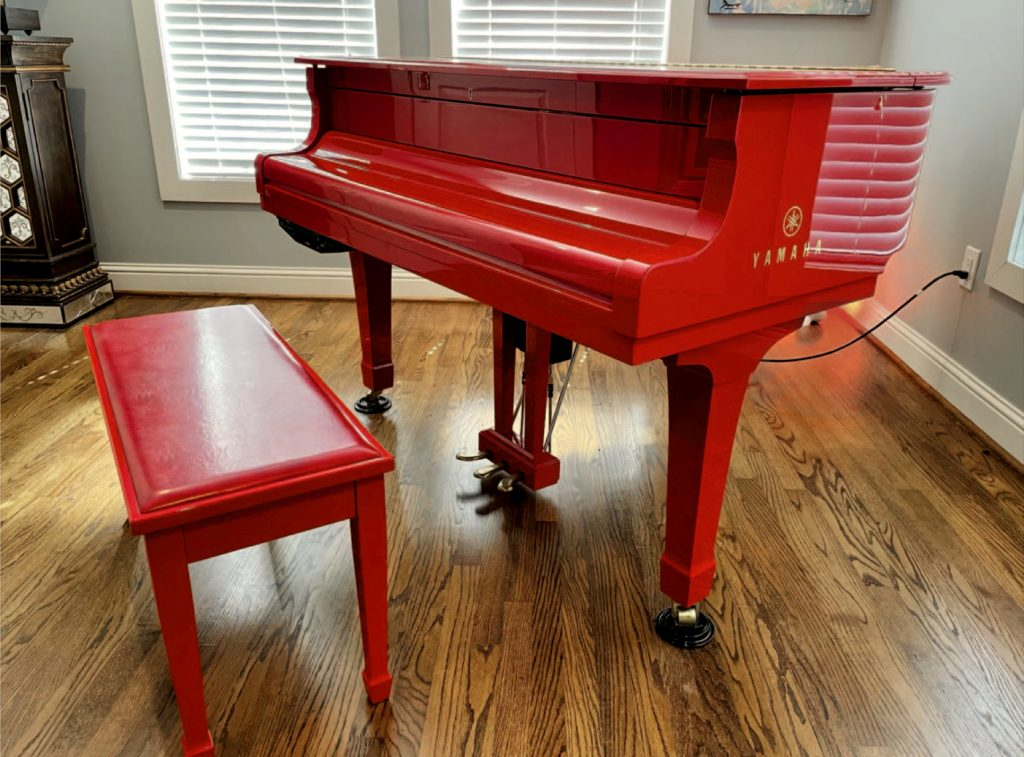 image of the Yamaha Elton John Limited Edition Signature Red piano on wooden floor