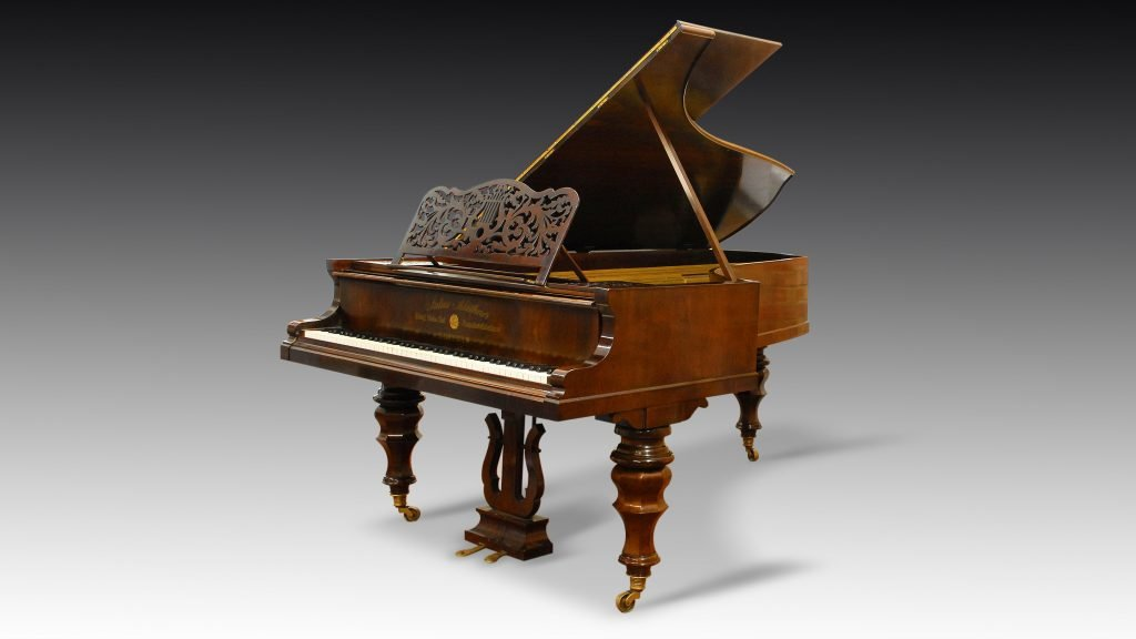 studio photograph of Blüthner grand piano
