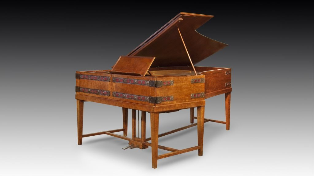 """studio photograph of Broadwood piano with hinged front """"doors"""" closed"""