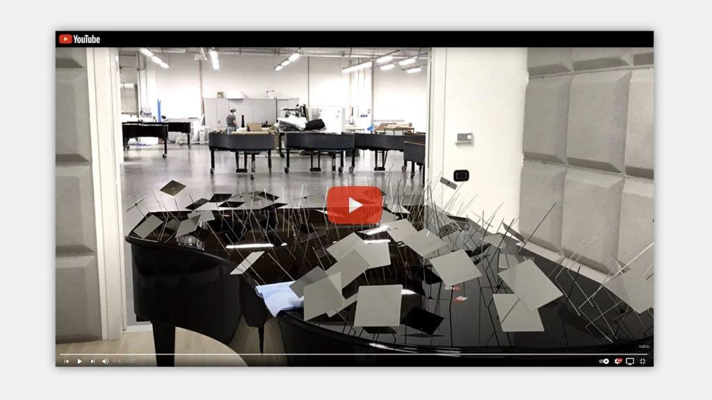 Link image to video showing assembly of the piano