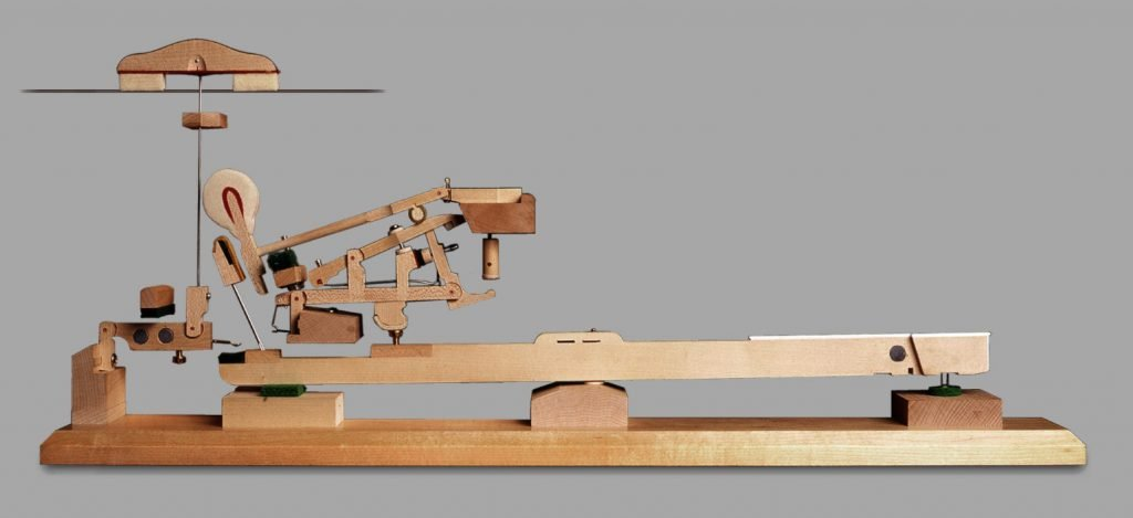 a model showing the double escapement action of a grand piano