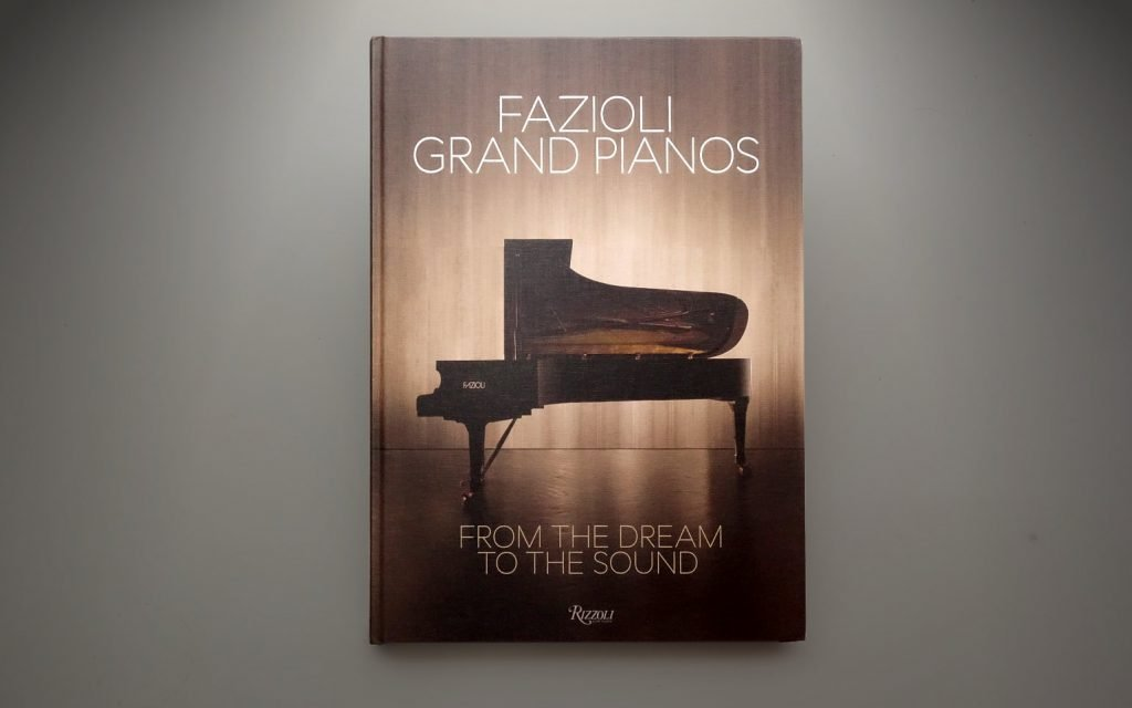 """image shows front cover of the new book """"Fazioli Grand Pianos: From the Dream to the Sound"""""""